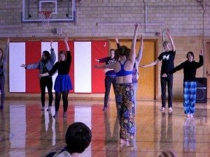 Students learning some Hula movements from 'KITH'.
