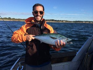 Eric Spicer '07 spent a lunch period with students discussing his post-Academy trajectory in the outdoor recreation industry.  Photo property of Oliver Hazard Perry Education at Sea.
