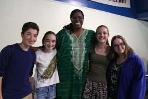 Dr. Kathy Bullock and assorted adoring students.  Photo by Christina Gabriel.
