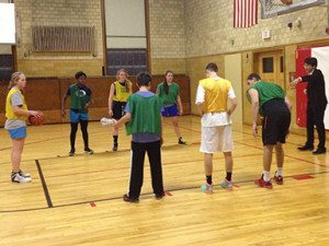 Regan Sun '14, serving as a referee during basketball practice.